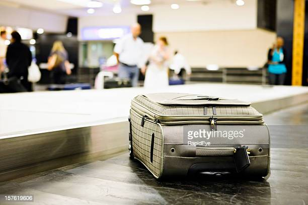 Single case on airport luggage carousel
