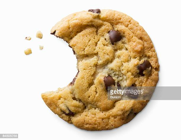 single chocolate chip cookie - chocolate chip cookie stock pictures, royalty-free photos & images