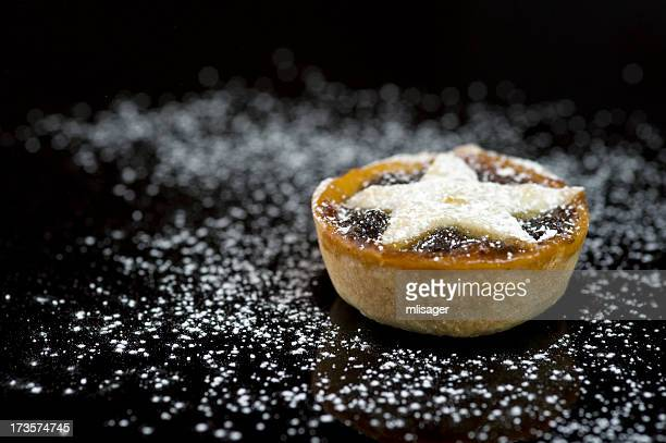 Single christmas mince pie on black background