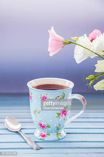 Single cup of tea with flowers