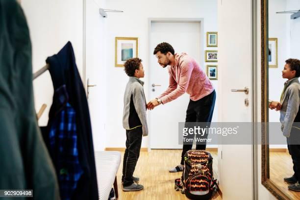 Single Dad Helping Son Get Read For School