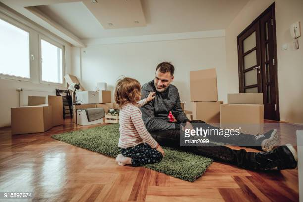 Single dad moving to a new house with his daughter