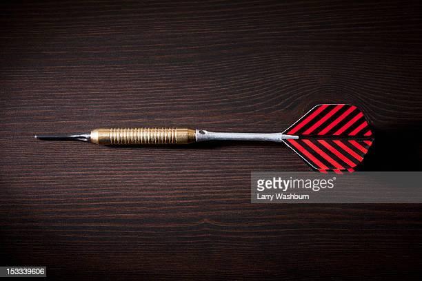 A single dart lying on its side