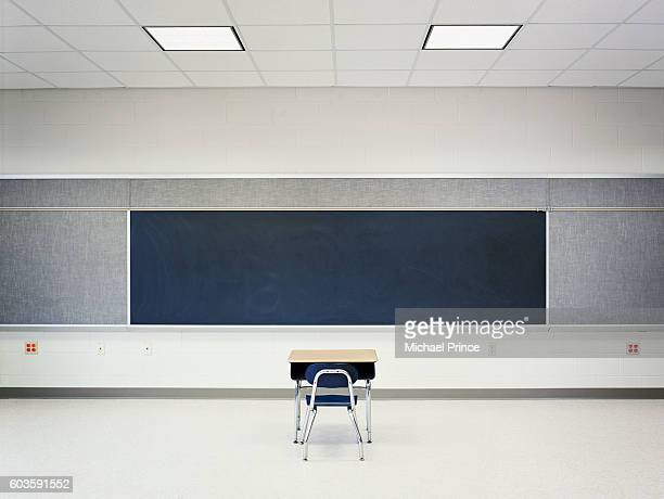 single desk in empty classroom - education stock pictures, royalty-free photos & images