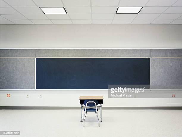 Single Desk in Empty Classroom