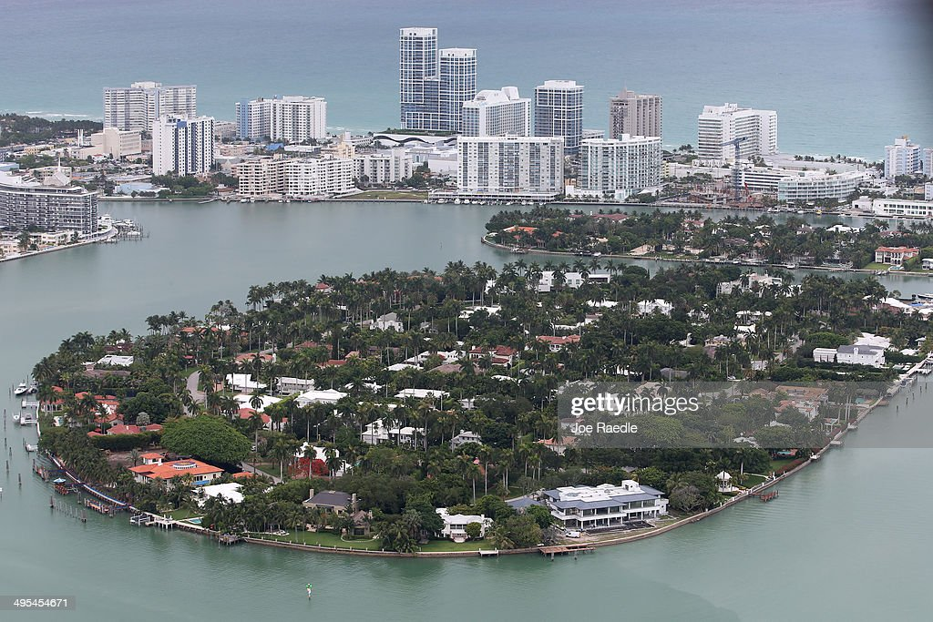 Single family homes on islands and condo buildings on ocean front property are seen in the city of Miami Beach June 3, 2014 in Miami, Florida. According to numerous scientists, south Florida could be flooded by the end of the century as global warming continues to melt the Arctic ice, in turn causing oceans to rise. U.S. President Barack Obama and the Environmental Protection Agency yesterday announced a rule that would reduce the nation's biggest source of pollution, carbon emissions from power plants, 30% by 2030 compared to 2005 levels. It is widely believed that these emissions are a main cause of global warming.