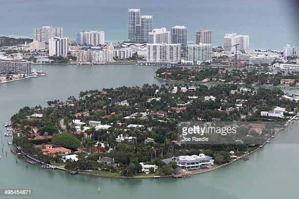 Single family homes on islands and condo buildings on ocean front property are seen in the city of Miami Beach June 3 2014 in Miami Florida According...
