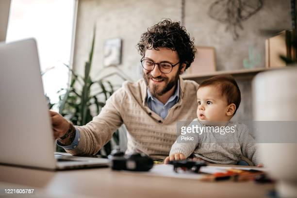 single father and baby in home office - family at home stock pictures, royalty-free photos & images