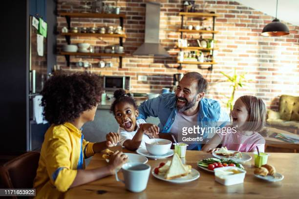 single father having breakfast with his kids - stepfamily stock photos and pictures