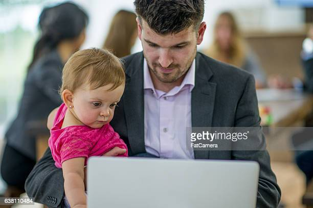 Single Father Working and Watching His Daughter