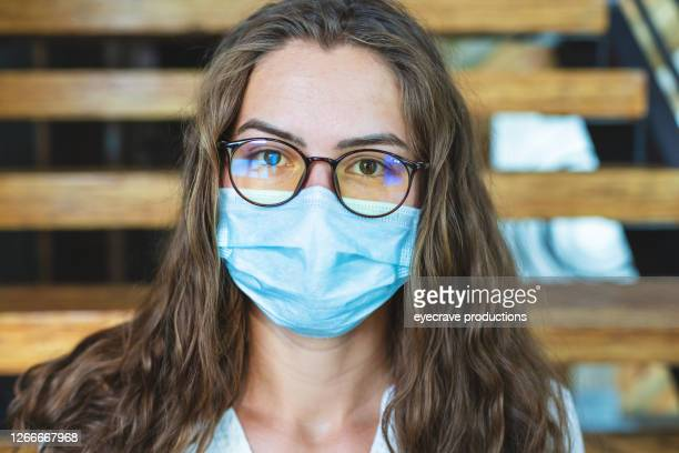 single female college student wearing a face mask looking at camera for close up portrait - eyecrave  stock pictures, royalty-free photos & images