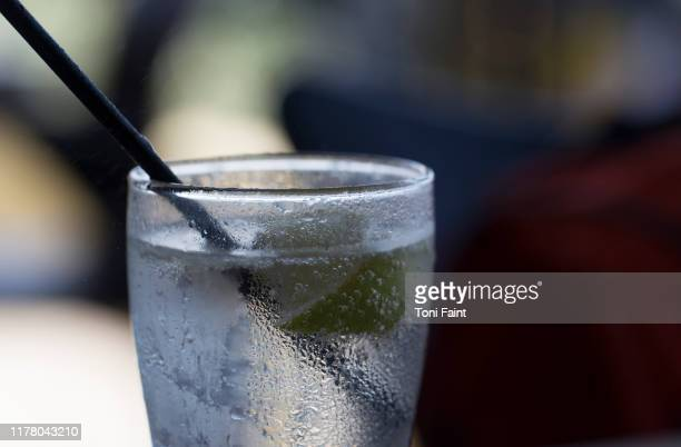 a single glass of vodka and soda water - carbonated water stock pictures, royalty-free photos & images
