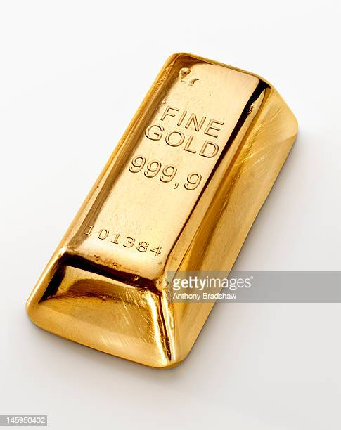 single gold ingot - gold bars stock photos and pictures
