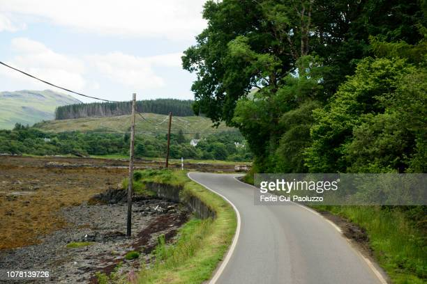 single lane road to tobermory, mull, scotland - argyll and bute stock photos and pictures