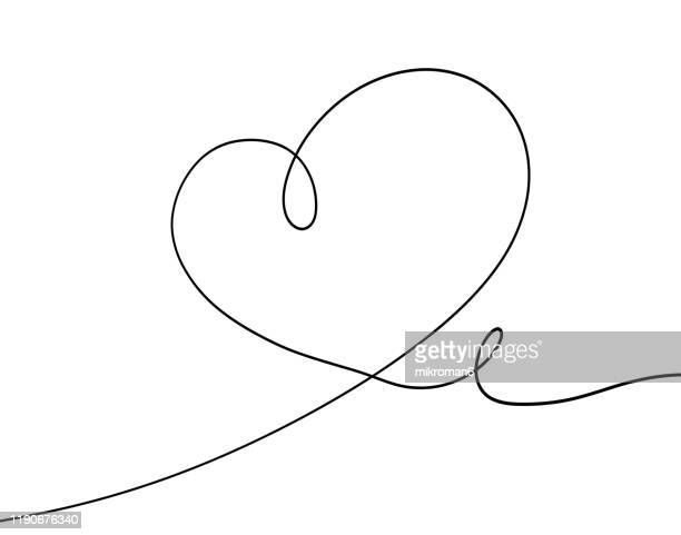 single line drawing of a heart - einzellinie stock-fotos und bilder