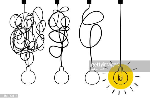 single line drawing of a light bulb - brainstormen stockfoto's en -beelden
