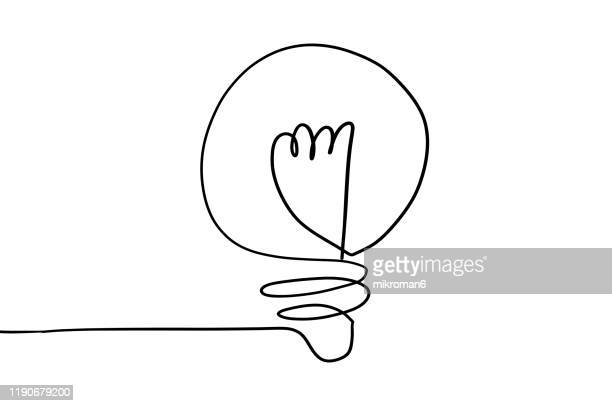 single line drawing of a light bulb - lineart stock-fotos und bilder
