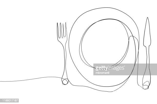 single line drawing of a plate and cutlery - lineart stock-fotos und bilder