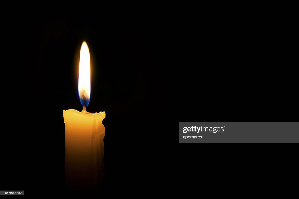 Single lit candle with quite flame : Stock Photo