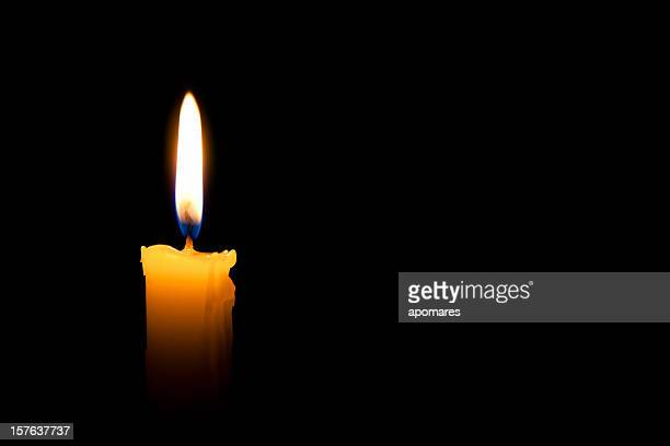 single lit candle with quite flame - flame stock pictures, royalty-free photos & images