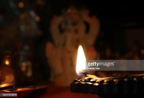 single lit clay diya/diwali/deepavali - goddess lakshmi stock photos and pictures