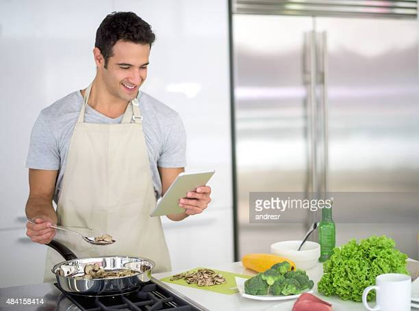 Single man cooking at home