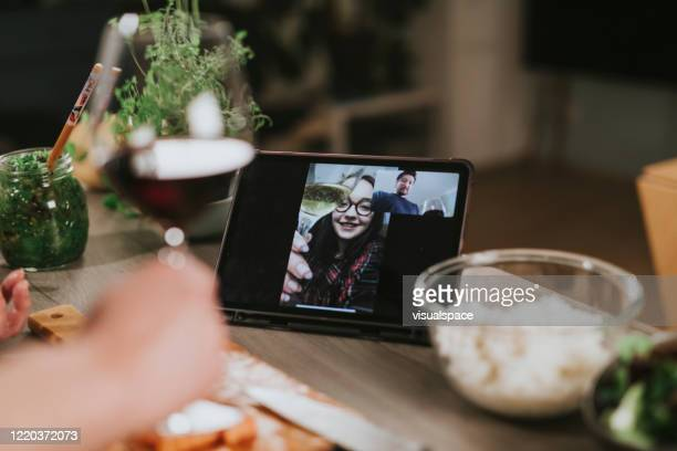 Single man is having a romantic dinner with video call during lockdown