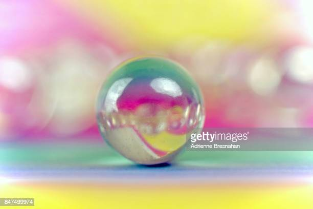 Single Marble on Multicolored Pastel Background