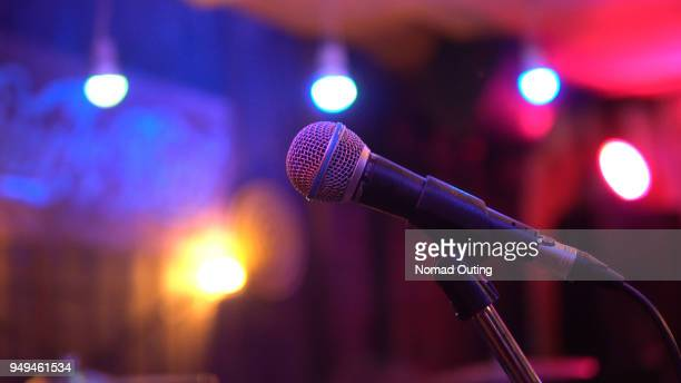 single microphone on the stage in nightclub - competition round stock photos and pictures