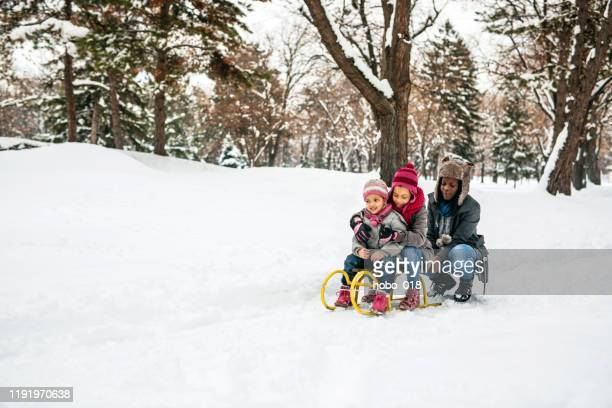 single mom playing with kids at snow - day stock pictures, royalty-free photos & images