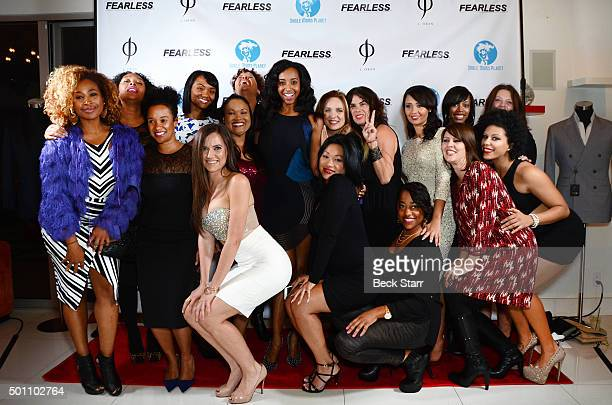 Single Moms Planet Founder/model Neferteri Plessy and Single Moms Planet board members attends Fearless Man And Single Moms Planet Holiday Party And...