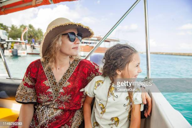 single mother and daughter traveling on a boat - tourboat stock pictures, royalty-free photos & images