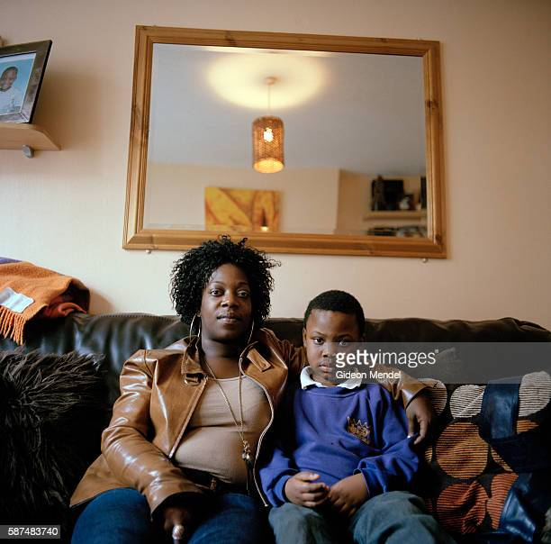 Single mother and her son in their flat on the Kingsmead Estate in Homerton in the eastern part of Hackney. The estate has 980 flats and houses more...