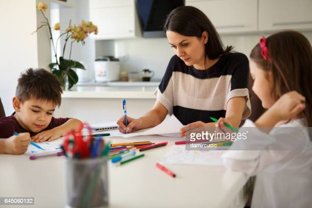 Single mother with children working from home