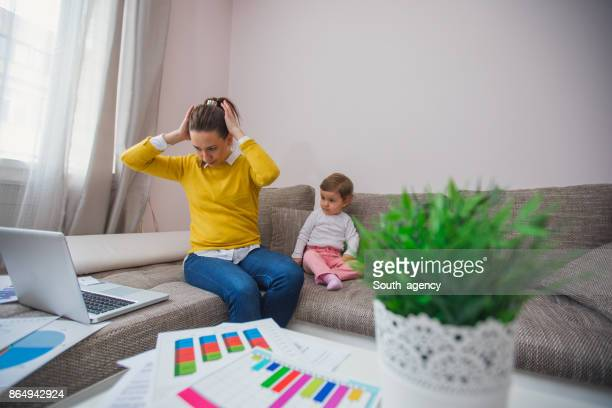 Single mother working at home