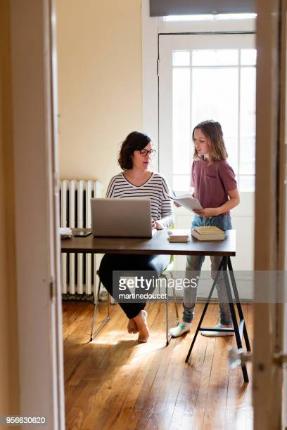 Single mother working from home with preteen daughter.