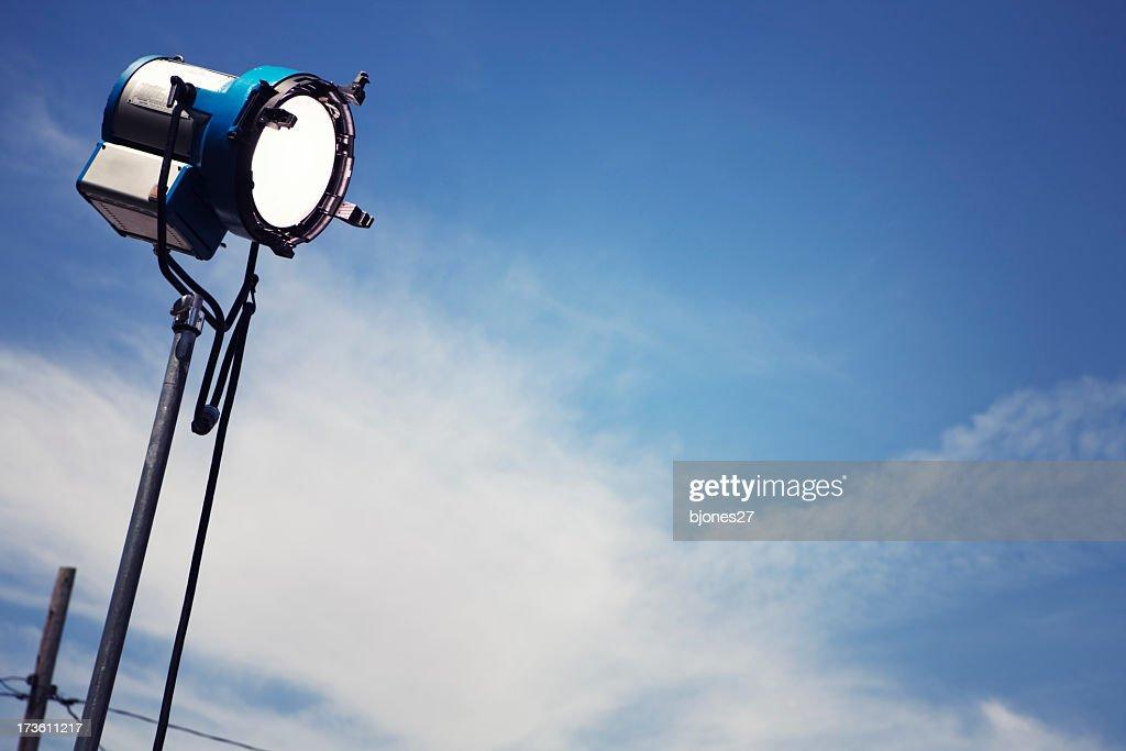 A single movie light with a sky background : Stock Photo