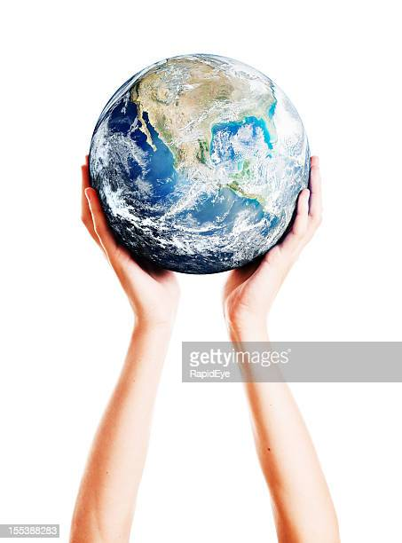 Single pair of graceful feminine hands supporting Earth
