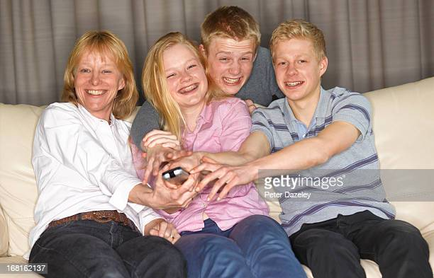 Single parent family fighting over remote control