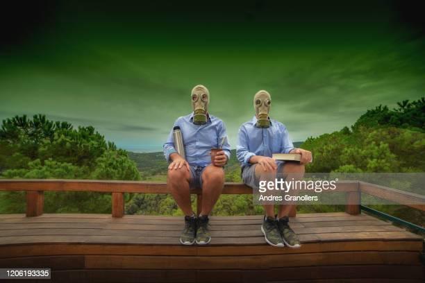 a single parent family photo in a toxic future - politieke partij stockfoto's en -beelden