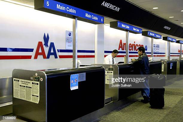 A single passenger checks in at the American Airlines ticket counter at San Francisco International Airport September 11 2003 in San Francisco...