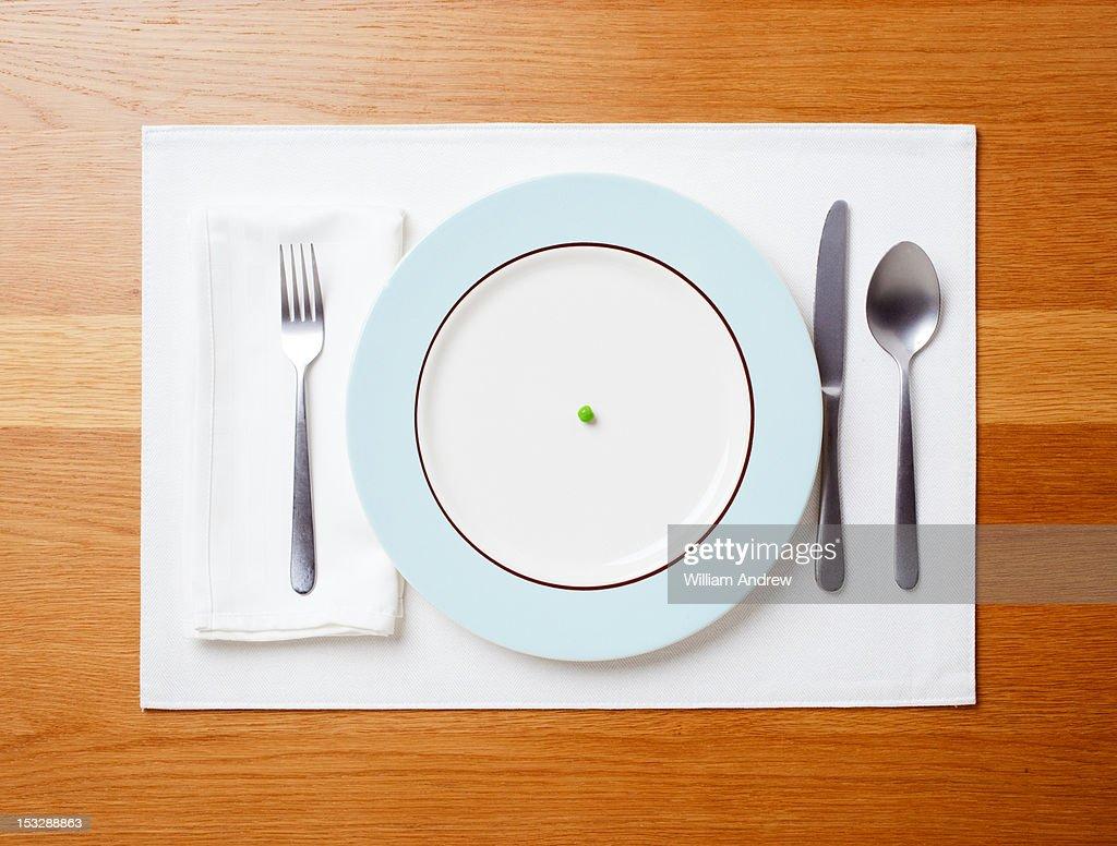Single pea on a plate : Stock Photo