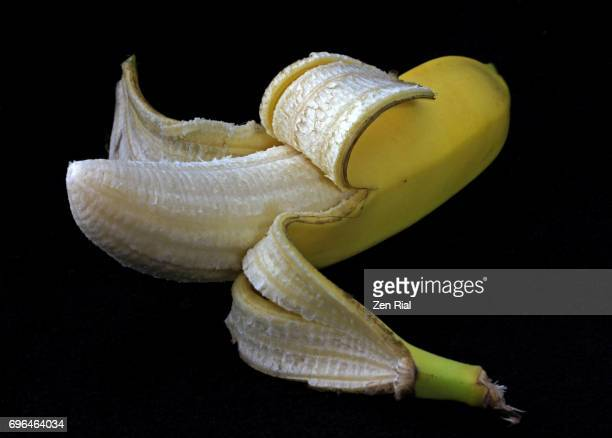 Single peeled Banana on black background- Grand Nain or Grande Naine, Cavendish Banana