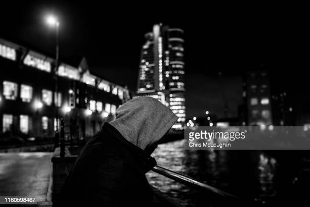 single peron standing by the river aire in leeds - drug abuse stock pictures, royalty-free photos & images