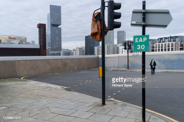 Single person crosses a pedestrian crossing that otherwise leads nowhere in Stratford during the second wave of the Coronavirus pandemic, on 26th...