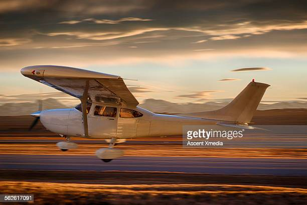 Single prop plane during liftoff from airport