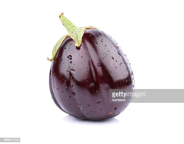 a single purple eggplant on a white background - eggplant stock photos and pictures