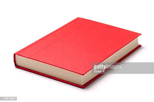 a single red book on a white surface - boek stockfoto's en -beelden