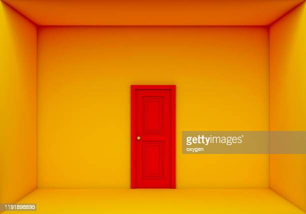 single red door closed on the yellow box room, 3d rendering - orange farbe stock-fotos und bilder