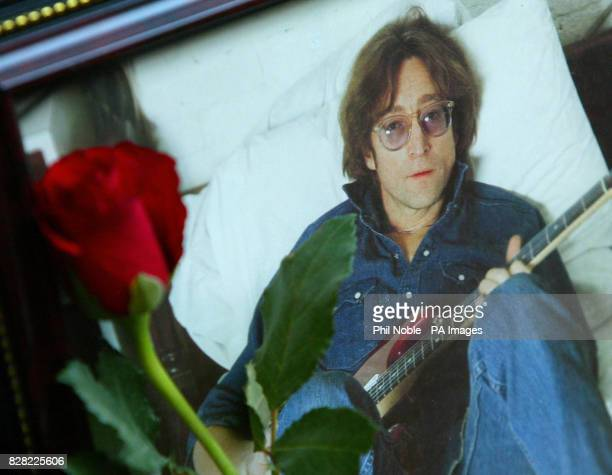 A single red rose is placed next to a photograph of late Beatle John Lennon near to a statue of The Beatles in the Cavern Walk shopping centre in...